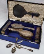 A George V silver part dressing table set, including a hand mirror,