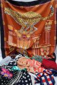 A Salvatore Feragamo silk scarf, together with Jaeger silk scarves,