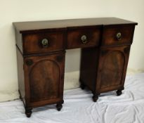 A 19th century mahogany sideboard the top with an inverted breakfront,