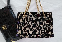 A Gucci handbag, with a stumpwork geometric pattern with a gilt metal handle,