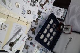 A collection of Royal Air force commemorative coin covers together with World at War silver coins,