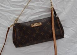 A small Louis Vuitton monogram clutch bag, with a leather shoulder strap,