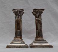 A pair of Victorian silver corinthian column candlesticks,
