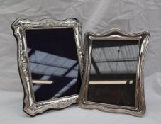 A modern silver photograph frame, embossed with a shell and leaves with a beaded border, Sheffield,