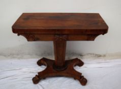A Victorian rosewood card table, the rectangular top with rounded corners,