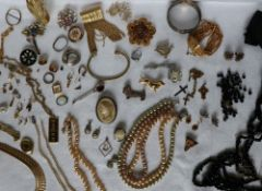 Assorted costume jewellery including faux pearls, brooches, pendants, bangle,