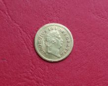 A George III gold 1/3 Guinea dated 1801