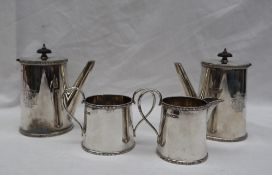 A George V silver four piece set comprising a pair of chocolate pots,