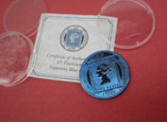 A Pobjoy Mint £5 Titanium Tuppery Blue coin with certificate