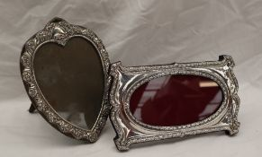 A modern Britannia standard silver photograph frame, decorated with bell flowers 19cm x 11.