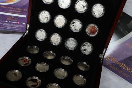 """Royal Mint - A set of twenty four silver coins """"Scenes in silver - The Lord of The Rings"""","""