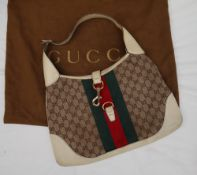 A Gucci Monogram Hobo handbag,