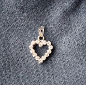 An 18ct white gold heart set with fourteen round brilliant cut diamonds each approximately 0.