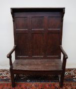 An 18th century and later oak settle,