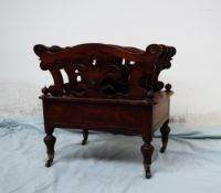 A Victorian rosewood Canterbury with three sections,
