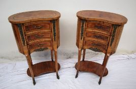 A pair of continental kidney shaped walnut side tables,