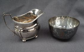 A George V silver cream jug, of oval form, with a gadrooned edge,
