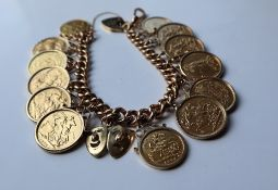 A 9ct gold solid curb bracelet mounted with nine sovereigns, dated 1912, 1898, 1904, 1896, 1889,