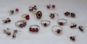 A 9ct yellow gold garnet set dress ring, together with a 9ct gold ring,