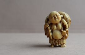 A 19th century Japanese ivory netsuke depicting Hotei standing holding a gourd flask with a sack