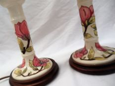 A pair of Moorcroft pottery candlestick table lamps,