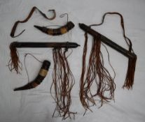 A leather quiver, with a shoulder strap and tassels,