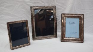 A modern silver photograph frame of rectangular form with an husked border, Sheffield, 2002,