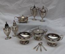 A George V silver five piece cruet set, comprising a pair of open table salts,