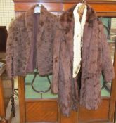 A fur coat together with fur stoles
