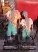 A pair of cast iron blackamoor type figures