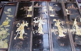A set of four Japanese lacquer and mother of pearl panels,