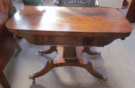 A Regency mahogany card table with a rectangular fold over top with a baize interior on a tapering