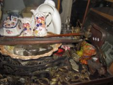 Pottery jugs, together with glass vases, pumps, horse brasses, ice skates,
