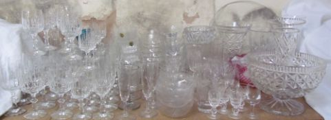 A large quantity of crystal and other drinking glasses, decanters, bowls,