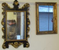 A mahogany and gilt decorated wall mirror with a heart shaped cresting and another gilt wall