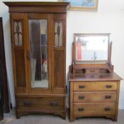 An Edwardian walnut two piece bedroom suite comprising a single door wardrobe and matching dressing