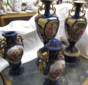 A pair of pottery vases decorated with Grecian figures in landscapes,