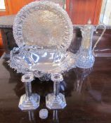A pair of silver desk candlesticks together with an electroplated swing handled cake basket,