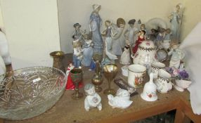 A collection of Lladro figures including ladies,