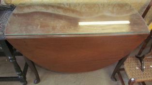 A 19th century mahogany gate leg dining table with drop flaps on cabriole legs and pointed pad