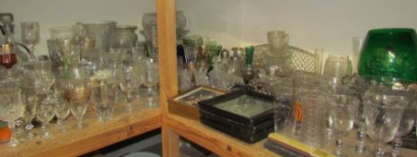 Assorted drinking glasses, together with vases, bowls, decanters, prints,
