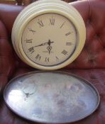 An electroplated gallery tray together with a wall clock