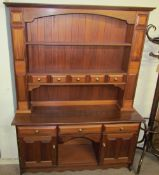A 20th century mahogany dresser, the rack with shelves and drawers,
