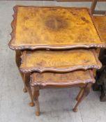 A 20th century walnut nest of three tables