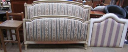 A pad upholstered double head and footboard together with a single headboard and a high stool