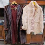 A National Fur Company coat together with another coat