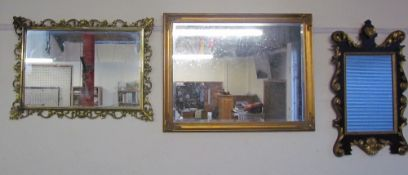 A gilt wall mirror together with a collection of modern wall mirrors