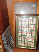Two albums of cigarette cards together with framed cigarette cards