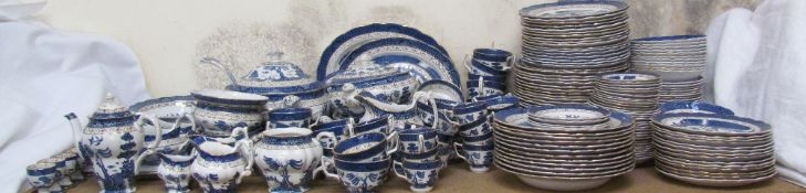 An Extensive Booths Real Old Willow pattern blue and white part dinner and tea set