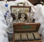 An oak cased tantalus together with a collection of decanters and a box of magic lantern slides